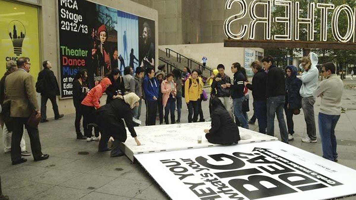 Community members were welcome to draw in the giant sketchbook