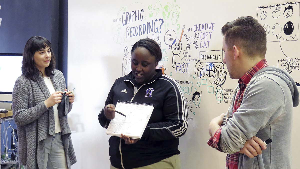 An EMBARC student explains her visual notes to the group