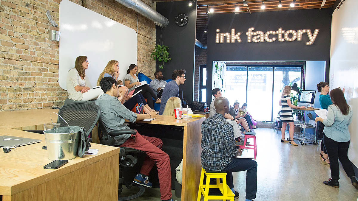 Co-op members take notes during the workshop in Ink Factory's Chicago space