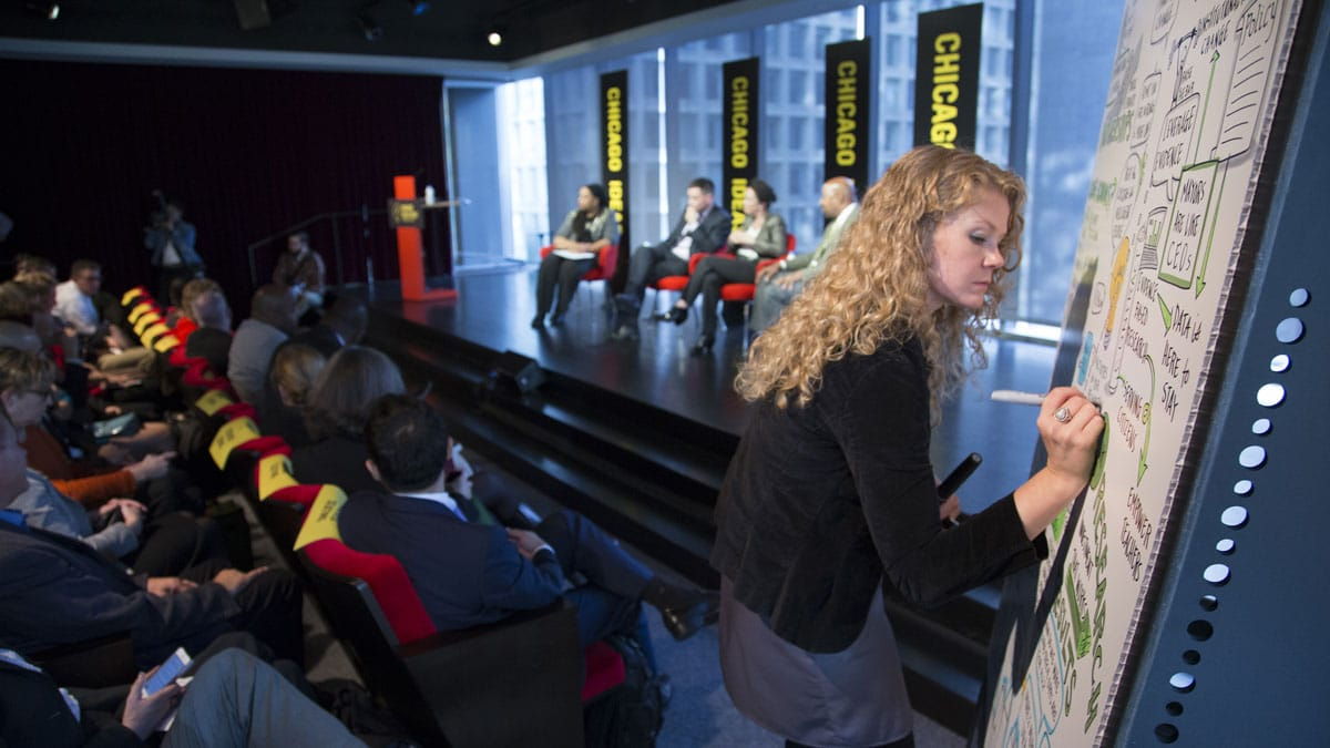 An artist draws live next to a panel discussion at Chicago Ideas