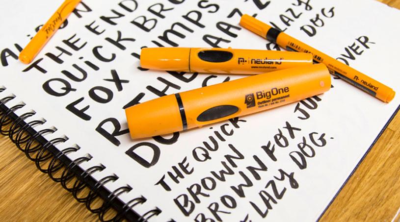 Markers on top of sketchbook