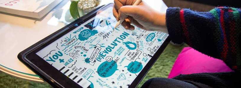 An artist creates digital visual notes on a Cintiq and visual note-taking app