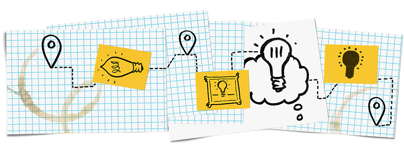 Lightbulbs drawn on grid paper and post-its