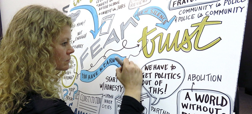 An artist draws live visual notes at Chicago Ideas Week