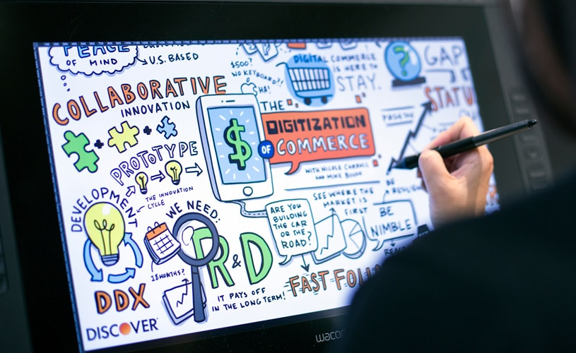 Artist works on tablet to create visual notes for a webinar