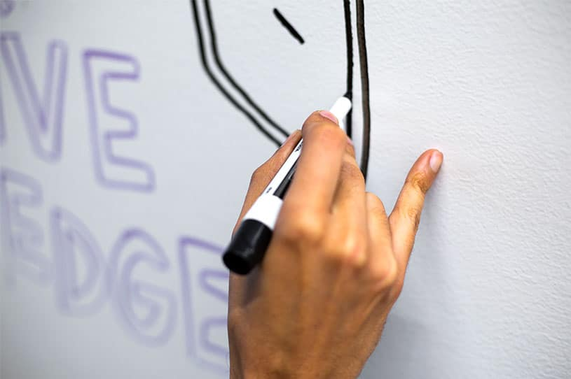Use your pinky to stabilize your hand when writing down your office whiteboard ideas
