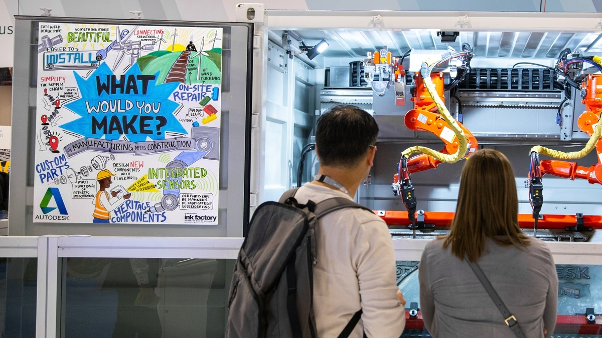 Attendees watch a robot demonstration next to visual notes