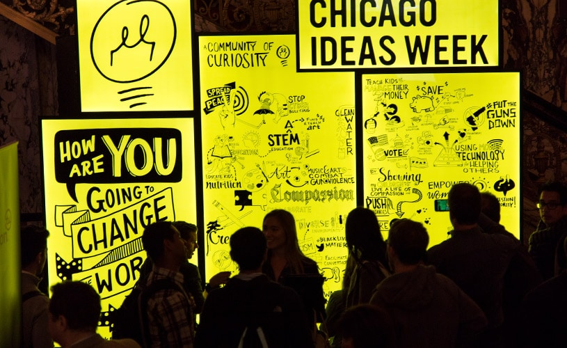 Visual notes taken on a large LED panel sit on display at Chicago Ideas Week