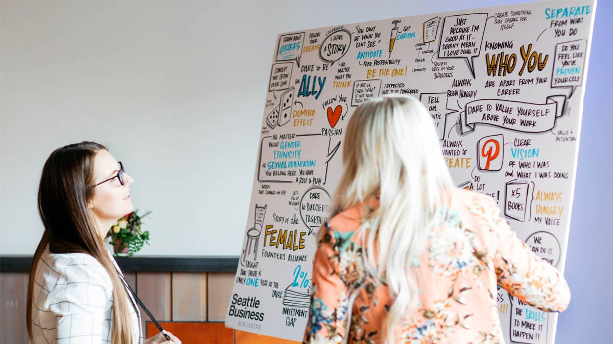 Event attendees look at visual notes created in real-time