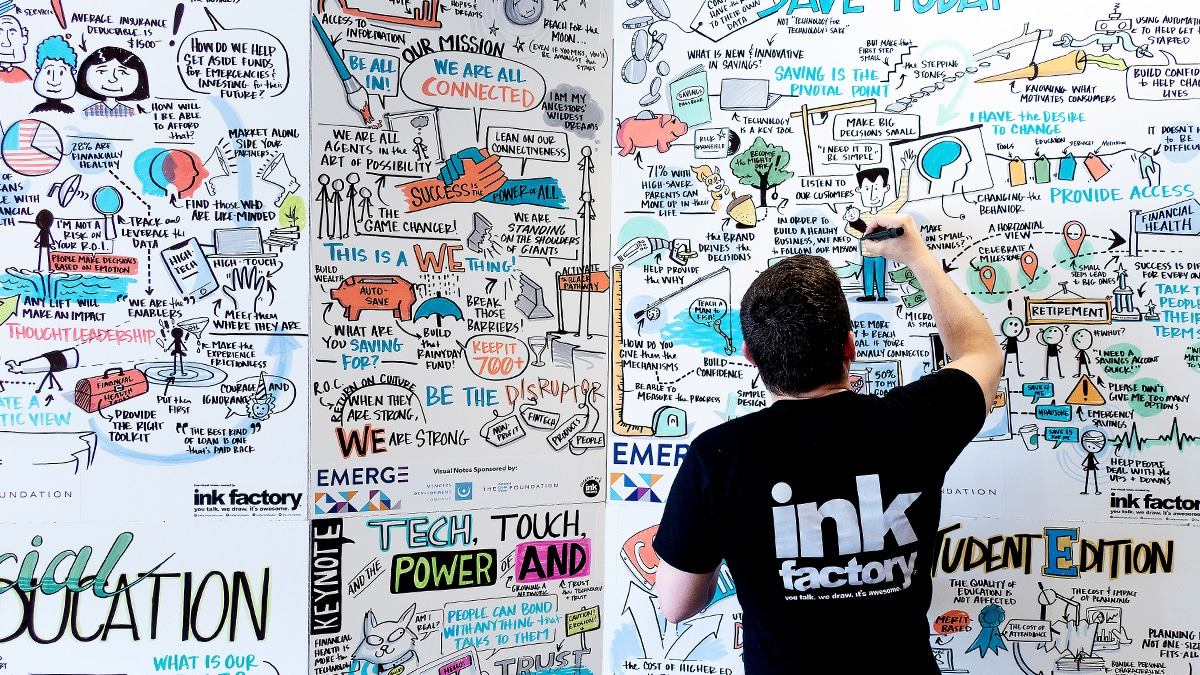 An artist creates in-person drawings for conferences