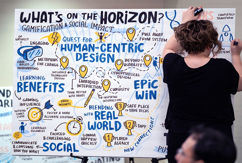 An artist makes the key points from a talk clear using hand lettering