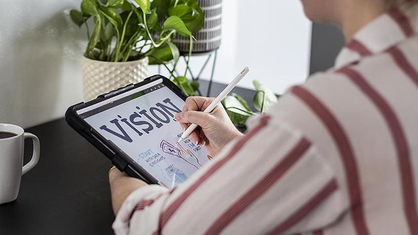 An artist draws live visual notes on a digital tablet